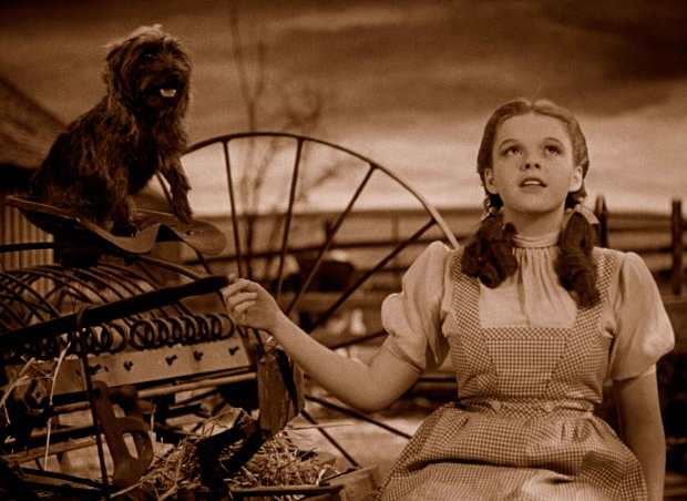 Irony: Dorothy signing about rainbows in a place with only sepia tones.
